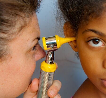 medicated: child cared for by doctors with love Stock Photo
