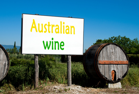 advertises: Traditional wooden barrel with a billboard that advertises the sale of wine in the Australian countryside Stock Photo