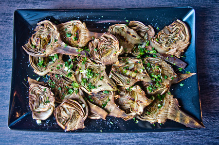purifying: artichokes baked in oven seasoned only with extra virgin olive oil, parsley and lemon are a healthy and purifying food to stay fit during the summer