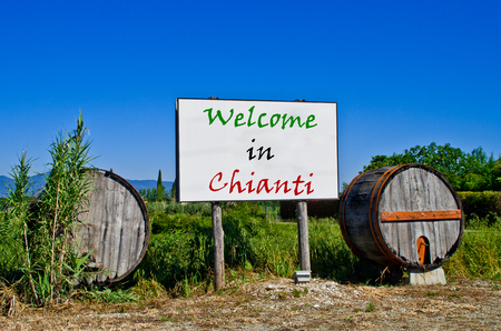 wine road: Billboard road surrounded by two wine barrels to welcome the tourists who come to visit the Chianti