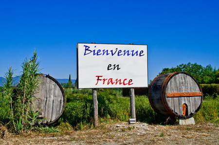 wine road: Billboard road surrounded by two wine barrels to welcome the tourists who come to visit France