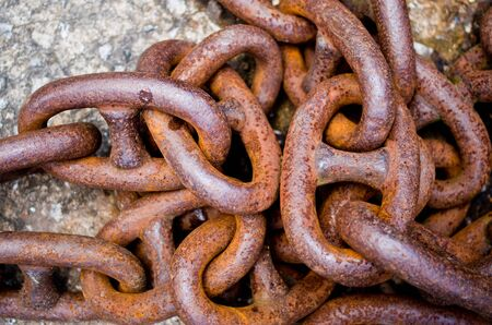 old rusty iron chains, knotted and worn from use