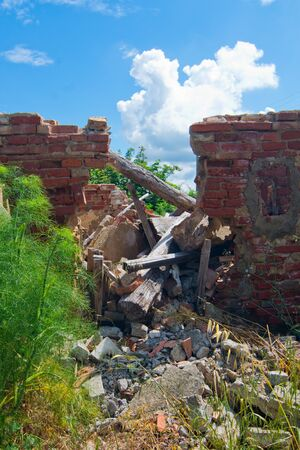 caved: broken beams of a collapsed roof in abandoned building