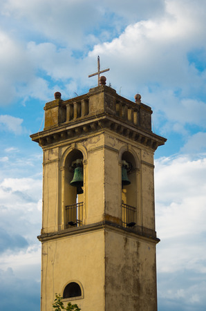 bell bronze bell: ancient bell tower made of masonry plastered with bronze bells, merlons and decorations Stock Photo