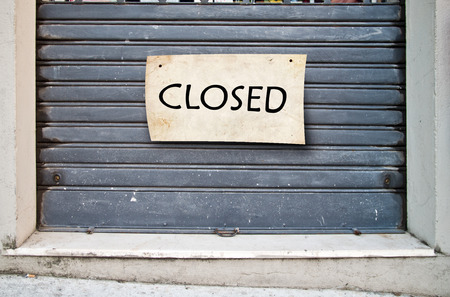 disgrace: sad lowered shutter of a closed company