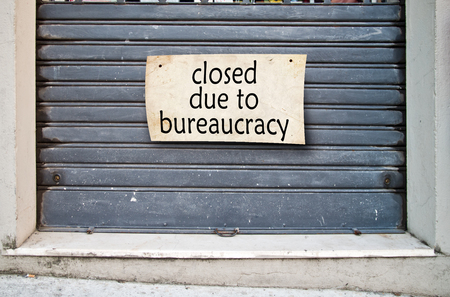bureaucracy: It lowered shutter of a closed company because of the bureaucracy that hinders the free initiative
