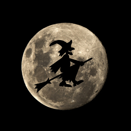 hallowen witch in the dark night is set against the silhouette of the moon