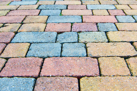 modular rhythm: paving stone bricks of different colors and of irregular composition