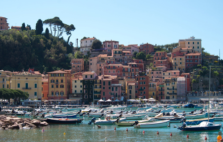 The seaside village of Lerici, overlooking the blue sea with its multi-colored palaces and the historic fortress