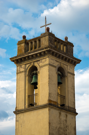 ancient bell tower made of masonry plastered with bronze bells, merlons and decorations Reklamní fotografie