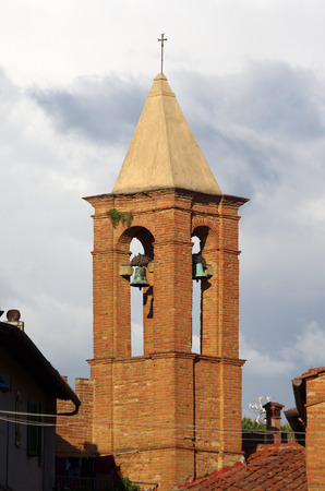 brick tower with bells ringing to tell the time Stock Photo