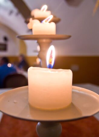 lit candles on a wooden table create a welcoming atmosphere, affection and love Stock Photo