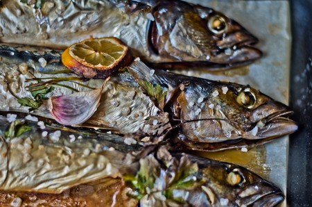 gutted: excellent fresh blue fish for a healthy diet freshly cooked with olive oil, lemon and herbs Stock Photo