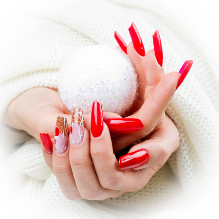 nails decorated with red, Christmas decorations and golden hues to celebrate your fantastic Christmas and New Years party