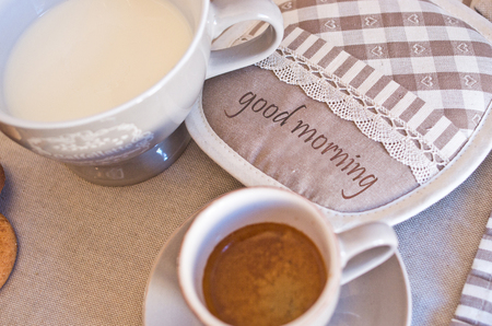 Table set for holidays or parties or for receptions, ready for breakfast with milk, coffee and cookies