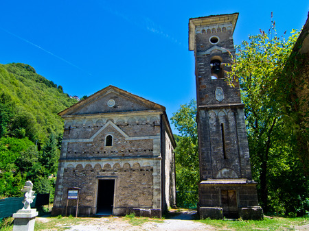 mountain church built in stone with bell tower with marble arches and decorations