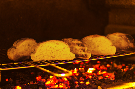 slices of crispy and abrasive bread on incandescent coal