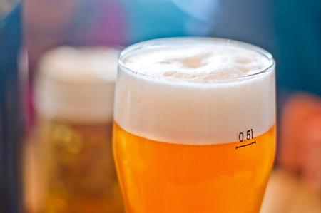 glass half-liter of fresh frothy beer