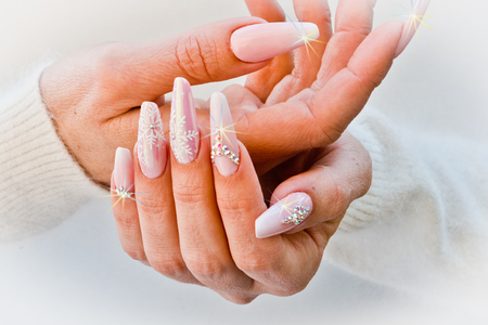 nails with pink decorations to celebrate Christmas and New Years party