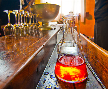 old bar with bottle of high-quality spirits and liqueur glasses ready to be filled Stok Fotoğraf