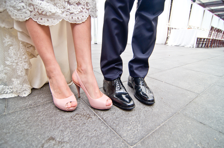 shoes of the newlyweds with wedding banquet background 写真素材