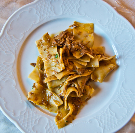pasta dish topped with hot and steamy sauce