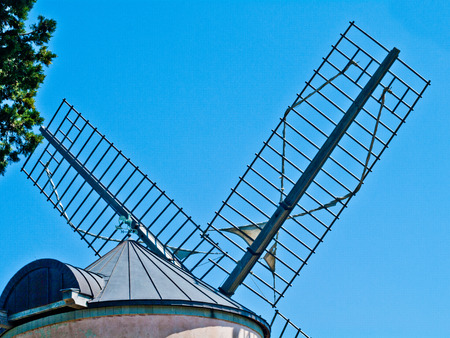 swords of the historic mill moved by the wind with the blue sky Stock Photo