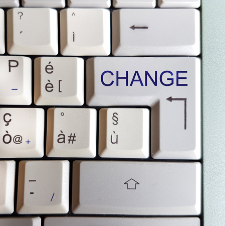 white computer keyboard with the word you are looking for:  change Stok Fotoğraf