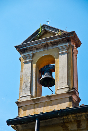 ancient bell tower in neoclassical style with bronze bells