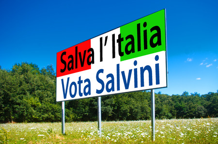 billboard in the middle of a field under the blue sky says that in the upcoming elections the only hope for saving Italy is to vote Lega Nord e Salvini