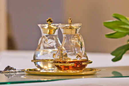 water and holy wine in small ampoules on the altar ready for Holy Mass