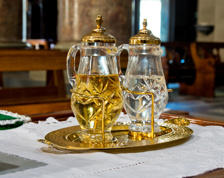 holy water and holy wine ready to turn into the blood of Jesus Christ during mass Stock Photo