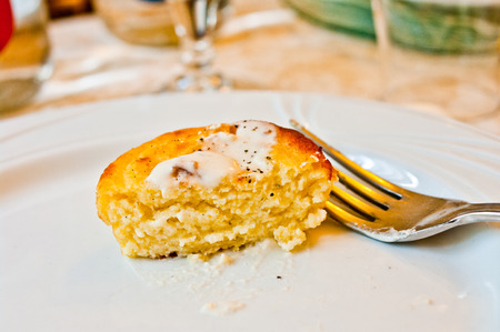 cheese pie in white plate and fork for your aperitif or appetizer