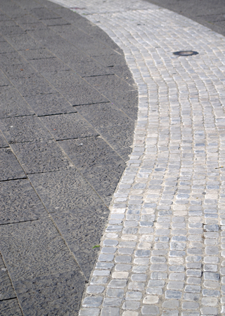 floor with large and small stone tiles that mark the path