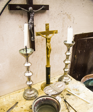 in the old parsonage there are old crucifixes, candles, incense and holy water, pronouns for holy mass
