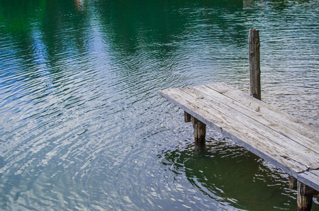 lake with fresh and clean spring water and small wooden pier
