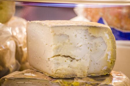 cave-aged pecorino cheese with aromatic herbs and black pepper ready to flavor your delicious dishes