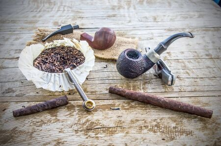 pleasure and enjoyment of slow smoking, its tools, pipe, tobacco, cigar, tampering, lighter,
