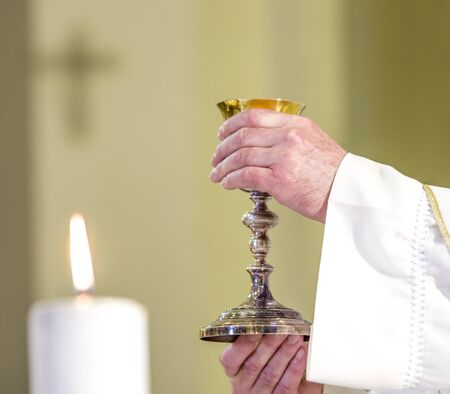 chalice with wine, consecrated in the blood of the risen Christ, ready for the communion of the faithful during mass
