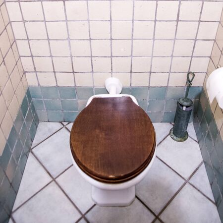 public bathroom, with cup, flush, water, clean and dirty environment; closed