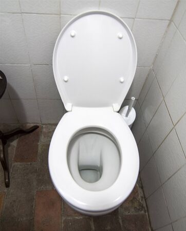 public bathroom, with cup, flush, water, clean and dirty environment; seat down Stock fotó