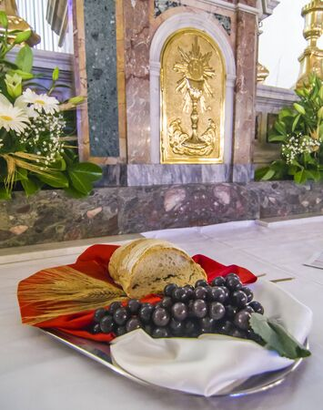 church altar with bread and grapes to become the body and blood of jesus christ during the holy mass