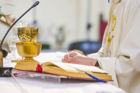 altar with consecrated host that becomes the body of jesus christ and chalice for wine, blood of christ, in the church of francesco papa in rome Archivio Fotografico