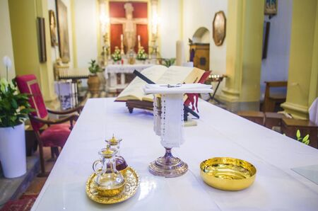 chalice for wine, blood of christ, and ciborium with host, body of christ, and ampoules with wine and water for the consecration on the others of the churches for pope francesco Foto de archivo