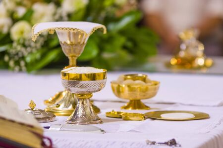 altar with consecrated host that becomes the body of jesus christ and chalice for wine, blood of christ, in the church of francesco papa in rome