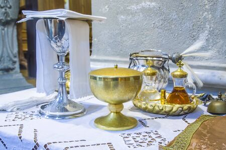 chalice for wine, blood of christ, and ciborium with host, body of christ, and ampoules with wine and water for the consecration on the others of the churches for pope francesco
