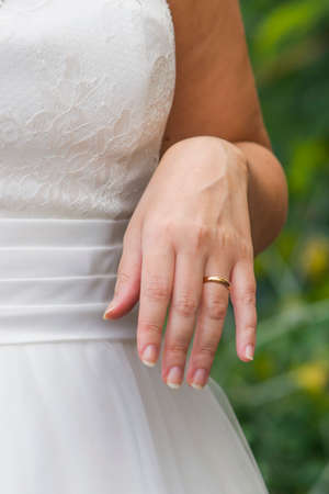 fingers of the young spouses play touch the rings of love that they have given themselves for a lifetime