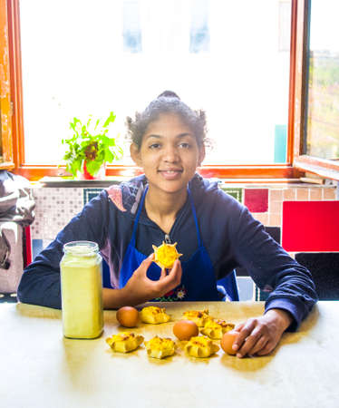 young girl cook cooks delicious pastries made with fresh eggs, ricotta and cream