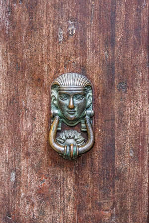 sphinx, artistic metal knocker created by craftsman for the ancient door