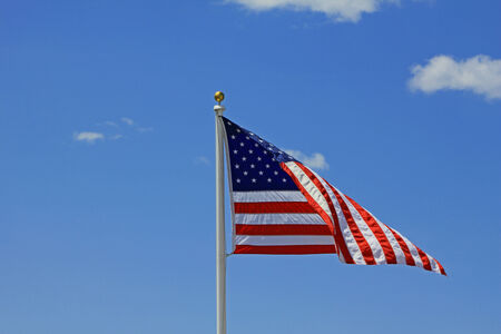 American Flag against a summer afternoon sky